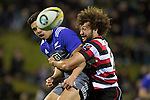 Orbyn Leger jolts the ball free from Anton Lienert-brown's grasp as he makes the tackle.  The game of Three Halves, a pre-season warm-up game between the Counties Manukau Steelers, Northland and the All Blacks, played at ECOLight Stadium, Pukekohe, on Friday August 12th 2016. Photo by Richard Spranger.