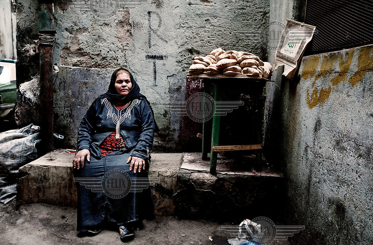 A woman sells bread on her stall in Bulaq.