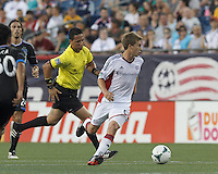 New England Revolution midfielder Scott Caldwell (6) brings the ball forward.  In a Major League Soccer (MLS) match, the New England Revolution (white) defeated San Jose Earthquakes (black), 2-0, at Gillette Stadium on July 6, 2013.