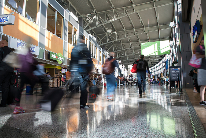 Passengers walk through the food court in Barbara Jordan Terminal at ABIA - Austin Bergstrom International Airport.