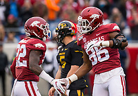 Hawgs Illustrated/BEN GOFF <br /> Deon Edwards (left), Arkansas linebacker, and Jamario Bell, Arkansas defensive end, celebrate after a stopping Missouir for a loss in the third quarter Saturday, Nov. 29, 2019, at War Memorial Stadium in Little Rock.