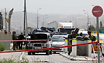 Israeli security forces gather at the site where a Palestinian teenager attempted to stab an Israeli soldier before being shot, at the Hawara checkpoint near the West Bank city of Nablus, on April 26, 2017. A Palestinian teenager was shot and criticially injured by Israeli forces on Wednesday afternoon after the teen allegedly attempted to stab Israeli soldiers stationed at the Huwwara military checkpoint south of Nablus in the northern occupied West Bank, according to the Israeli army and Israeli media. Photo by Ayman Ameen