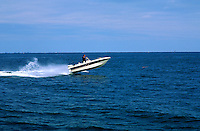 A sport fishing boat travelling at high speed.