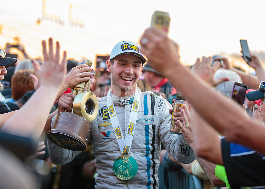 Nov 11, 2018; Pomona, CA, USA; NHRA pro stock driver Tanner Gray celebrates after winning the Auto Club Finals at Auto Club Raceway. Mandatory Credit: Mark J. Rebilas-USA TODAY Sports