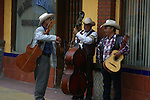 LOCAL MEN ENTERTAIN WITH TRADITIONAL MEXICAN MUSIC ON STREET IN TIJUANA