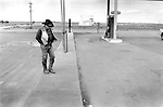 Denton Texas USA 1999. A lone cowboy at a petrol station..