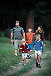 A family of five enjoy a hiking experience in Moraine Park, Rocky Mtn Nat'l Park, CO