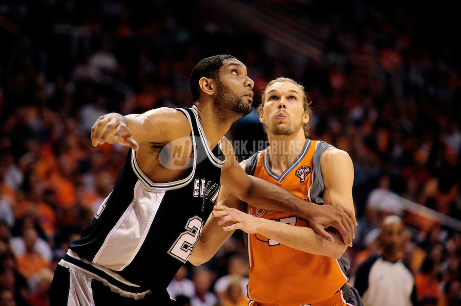 May 5, 2010; Phoenix, AZ, USA; San Antonio Spurs forward (21) Tim Duncan and Phoenix Suns forward Louis Amundson in game two in the western conference semifinals of the 2010 NBA playoffs at the US Airways Center. The Suns defeated the Spurs 110-102. Mandatory Credit: Mark J. Rebilas-