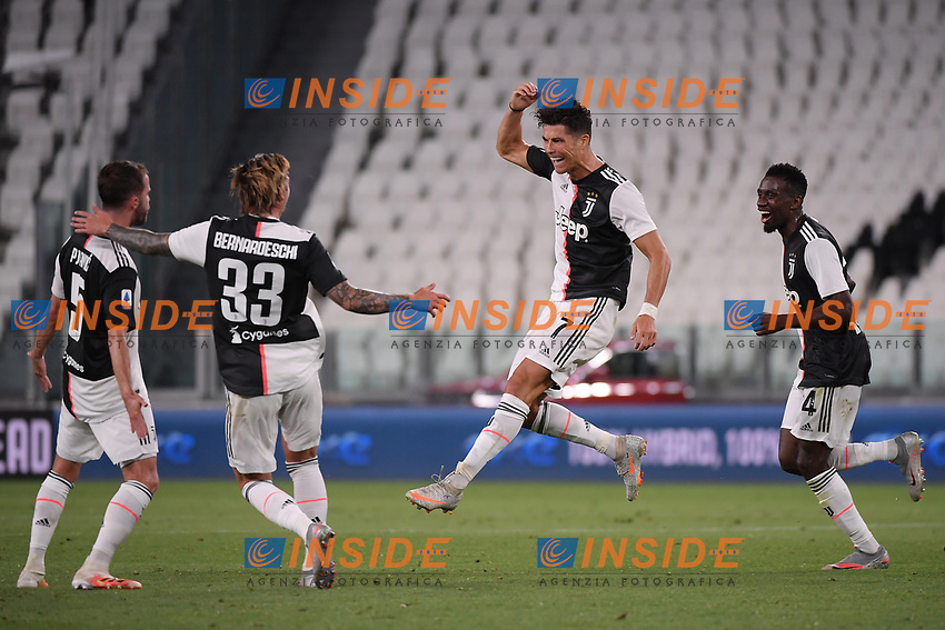 Cristiano Ronaldo of Juventus celebrates with Miralem Pjanic, Federico Bernardeschi and Blaise Matuidi after scoring the goal of 1-0 during the Serie A football match between Juventus FC and UC Sampdoria at Juventus stadium in Turin (Italy), July 26th, 2020. Play resumes behind closed doors following the outbreak of the coronavirus disease. <br /> Photo Federico Tardito / Insidefoto