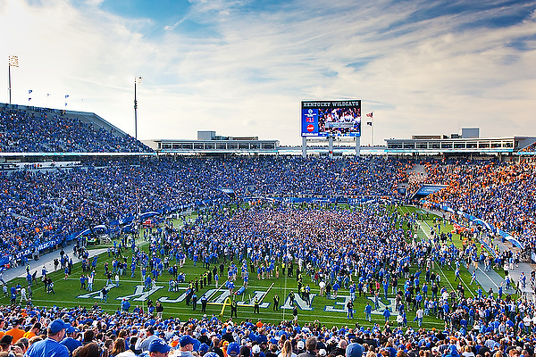 Fans rush the field after UK beat Tennessee for the first time since 1984. Kentucky hosted Tennessee at Commonwealth Stadium, in Lexington,  Nov. 26, 2011. Photo by Derek Poore