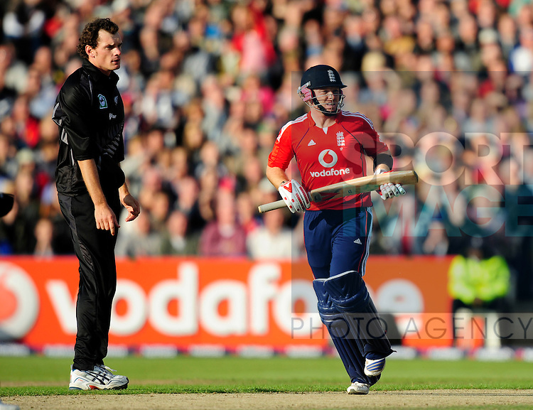 Ian Bell of England watches another boundary as a New Zealand bowler looks on