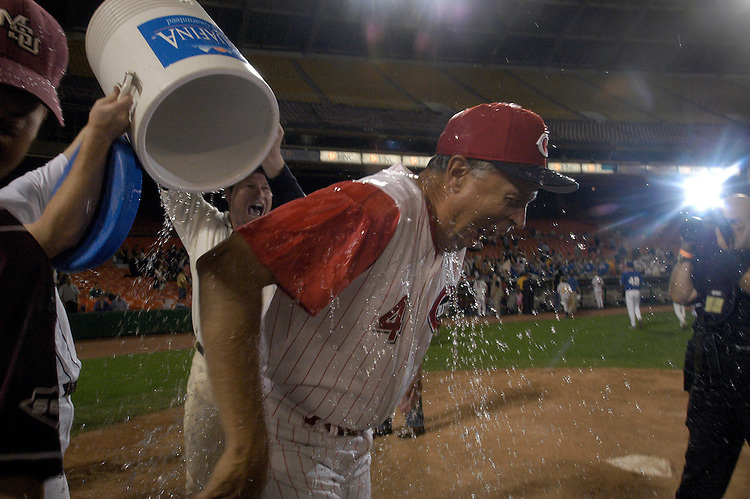 Coach Rep. Mike Oxley, R-Ohio, gets soaked by his teammates at end of the 44th Annual Congressional Baseball Game at RFK stadium. The GOP won 19-11.