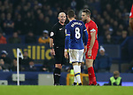 Ross Barkley of Everton and Jordan Henderson of Liverpool are spoken to by referee Mike Dean during the English Premier League match at Goodison Park, Liverpool. Picture date: December 19th, 2016. Photo credit should read: Lynne Cameron/Sportimage