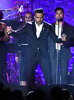 NEW YORK - JANUARY 27: Luis Fonsi performs at the 2018 Clive Davis Pre-Grammy Gala at the Sheraton New York Times Square on January 27, 2018 in New York, New York. (Photo by Frank Micelotta/PictureGroup)