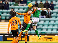 28th January 2020; Easter Road, Edinburgh, Scotland; Scottish Cup replay, Football, Hibernian versus Dundee United; Lawrence Shankland of Dundee United and Paul Hanlon of Hibernian compete for the header