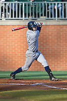 Grayson Lewis (22) of the Rice Owls follows through on his swing against the Charlotte 49ers at Hayes Stadium on March 6, 2015 in Charlotte, North Carolina.  The Owls defeated the 49ers 4-2.  (Brian Westerholt/Four Seam Images)