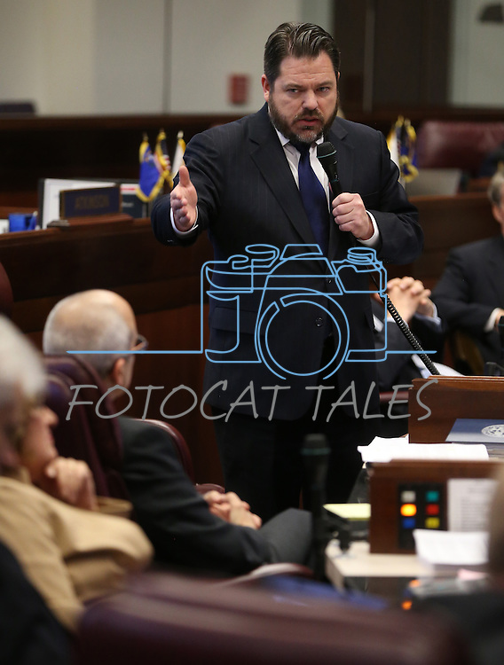 Nevada Senate Minority Leader Michael Roberson, R-Henderson, works on the Senate floor at the Legislative Building in Carson City, Nev., on Tuesday, May 21, 2013. .Photo by Cathleen Allison