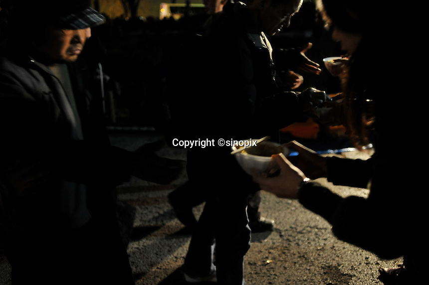 Homeless queue for food in Shinjuku Park, central Tokyo  15 February 2009.   The numbers of homeless has sky-rocketed in recent months according charity groups who distribute food and blankets.