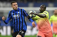 6th November 2019, Milan, Italy; UEFA Champions League football, Atalanta versus Manchester City; Josip Ilicic of Atalanta BC challenges Benjamin Mendy of Manchester City