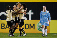 Carrie Dew (19)  of FC Gold Pride celebrates scoring with teammates Formiga (31), Rachel Buehler (4), and Eriko Arakawa (30) during the first half of a Women's Professional Soccer match against  Sky Blue FC at TD Bank Ballpark in Bridgewater, NJ, on April 11, 2009. Photo by Howard C. Smith/isiphotos.com