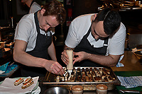 Melbourne, 17 June 2019 - Chef Charlie  Watson (left) preparing food at the launch of Lupo Restaurant in Smith Street, Melbourne, Australia. Photo Sydey Low / Asterisk Images.
