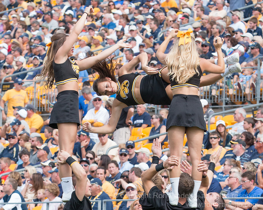 the Iowa cheerleaders perform. Iowa Hawkeyes defeated the Pitt Panthers 24-20 at Heinz Field, Pittsburgh Pennsylvania on September 20, 2014.