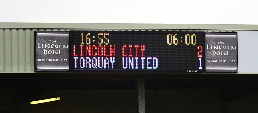 The score board at Lincoln City's Sincil Bank Stadium in second half injury time, showing the score as Lincoln City 2 - Torquay United 1<br /> <br /> Photographer Chris Vaughan/CameraSport<br /> <br /> Vanarama National League - Lincoln City v Torquay United - Friday 14th April 2016  - Sincil Bank - Lincoln<br /> <br /> World Copyright &copy; 2017 CameraSport. All rights reserved. 43 Linden Ave. Countesthorpe. Leicester. England. LE8 5PG - Tel: +44 (0) 116 277 4147 - admin@camerasport.com - www.camerasport.com