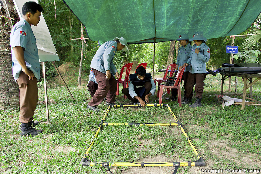 SVAY RIENG, CAMBODIA. A CMAC team prepares the Ebinger UPEX-740M, one of the mine identification system used by CMAC in Cambodia. Photography: ©Omar Havana