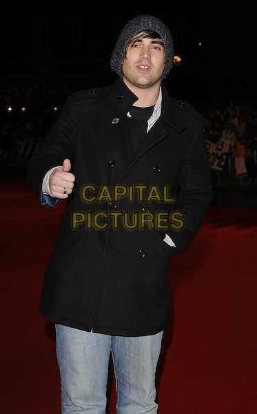"CHARLIE SIMPSON.""Remember Me"" UK Film Premiere - Arrivals held at Odeon cinema, Leicester Square, London, England..March 17th 2010 .half length black jacket coat jeans denim grey gray beanie hat hand in pocket thumb up .CAP/CAN.©Can Nguyen/Capital Pictures."