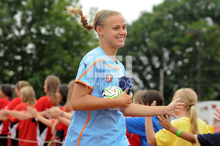 Carrie Dew (19) of Sky Blue FC greets fans before the match. Sky Blue FC and the Boston Breakers played to a 0-0 tie during a Women's Professional Soccer (WPS) match at Yurcak Field in Piscataway, NJ, on June 12, 2011.