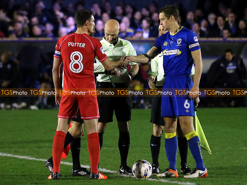 The two captains shake hands prior to kick-off during AFC Wimbledon vs MK Dons, Sky Bet EFL League 1 Football at the Cherry Red Records Stadium on 14th March 2017