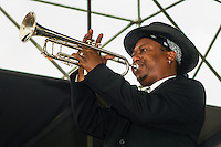 Kermit Ruffins plays the trumpet, Kermit Ruffins & The Barbeque Swingers, French Quarter Festival, Woldenberg Riverfront Park, New Orleans, Louisiana, USA