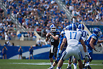 Quarterback Reese Phillips (12) looks for a pass during the Blue/White Spring Game in Lexington, Ky., on Saturday, April 26, 2014. Blue defeated White 38-14. Photo by Adam Pennavaria | Staff