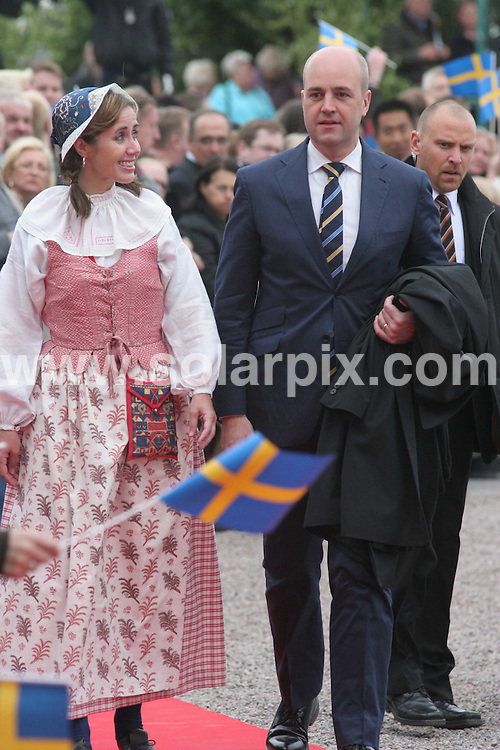 **ALL ROUND PICTURES FROM SOLARPIX.COM**.**SYNDICATION RIGHTS FOR UK AND SPAIN ONLY**.Princess Madeleine of Sweden opens the gates to the Stockholm Palace for the annual 'Open Palace' event, which allows public to visit the palace, as part of the celebrations of Swedish National Day. Stockholm, Sweden. 6 June 2009..This pic: Fredrik Reinfeldt and wife..JOB REF: 9194 PRT (Berggren   DATE: 06_06_2009.**MUST CREDIT SOLARPIX.COM OR DOUBLE FEE WILL BE CHARGED**.**ONLINE USAGE FEE GBP 50.00 PER PICTURE - NOTIFICATION OF USAGE TO PHOTO @ SOLARPIX.COM**.**CALL SOLARPIX : +34 952 811 768 or LOW RATE FROM UK 0844 617 7637**