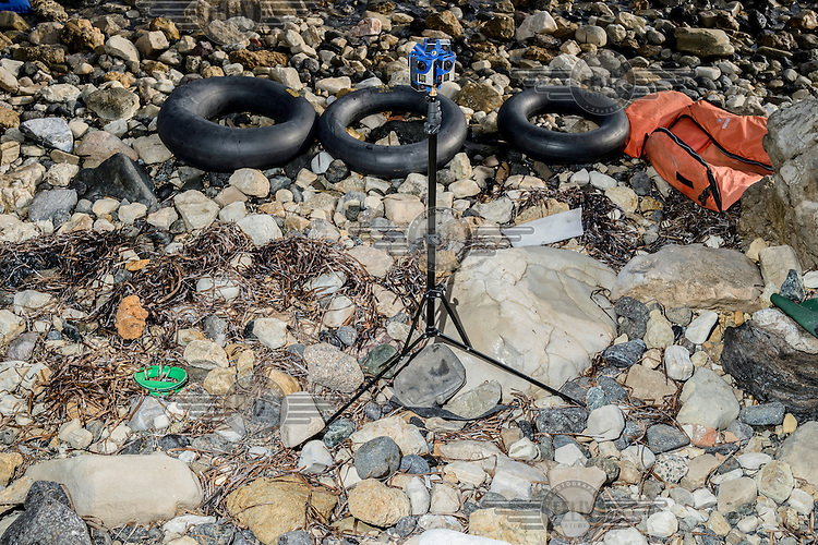 A virtual reality camera rig on a beach recording refugees as they are landing.