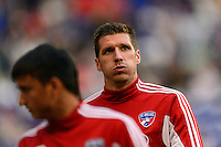 Kenny Cooper (33) of FC Dallas warms up on the sidelines. The New York Red Bulls defeated FC Dallas 1-0 during a Major League Soccer (MLS) match at Red Bull Arena in Harrison, NJ, on September 22, 2013.