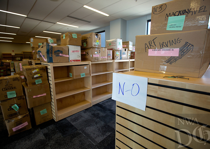 NWA Media/JASON IVESTER --08/21/2014--<br /> Boxes of books wait to be organized in the library stacks on Thursday, Aug. 21, 2014, inside the new Joplin High School in Joplin, Mo. The school was originally scheduled to open with the rest of the school district on Monday, Aug. 25, but was pushed back to Tuesday, Sept. 2.
