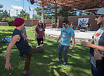 People play hackey sack as the band Wasted Noise played in the background during the inaugural Bud and Brew Music Festival in Wingfield Park in downtown Reno on Saturday, Sept. 23, 2017.