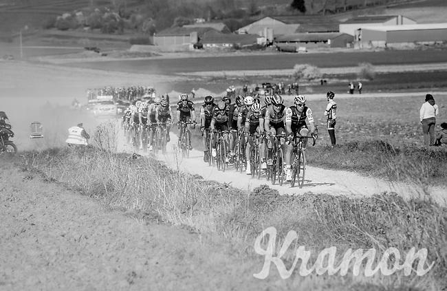 2nd peloton racing over the newly added gravel roads around Ploegsteert, called 'Plugstreets'<br /> <br /> 79th Gent-Wevelgem 2017 (1.UWT)<br /> 1day race: Deinze &rsaquo; Wevelgem - BEL (249km)