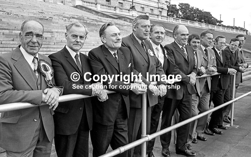 United Ulster Unionist Council, UUUC, candidates, in the October 1974 UK General Election pose for a group photograph in front of Stormont Buildings, Belfast, N Ireland. From left: Johnny McQuade, James Molyneaux, Enoch Powell, Rev Ian Paisley, James Kilfedder, Harry West, John Carson, William Craig, Rev Robert Bradford, Harold McCusker and William Ross. They were united in their opposition to the Sunningdale Agreement. Their grouping captured 11 of the 12 Northern Ireland seats. 197410000570a<br />