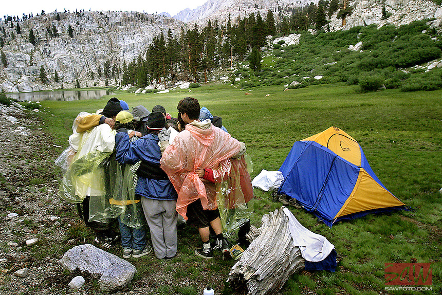 Bonding in the Wilderness, the teens gather for a private meeting and prayer before dinner.