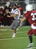 NWA Democrat-Gazette/ANDY SHUPE<br /> Taylor Powell of Fayetteville scrambles while under pressure from Mason Hutchins of Springdale Friday, Oct. 9, 2015, during the first half of play at Jarrell Williams Bulldog Stadium in Springdale. Visit nwadg.com/photos to see more photographs from the game.
