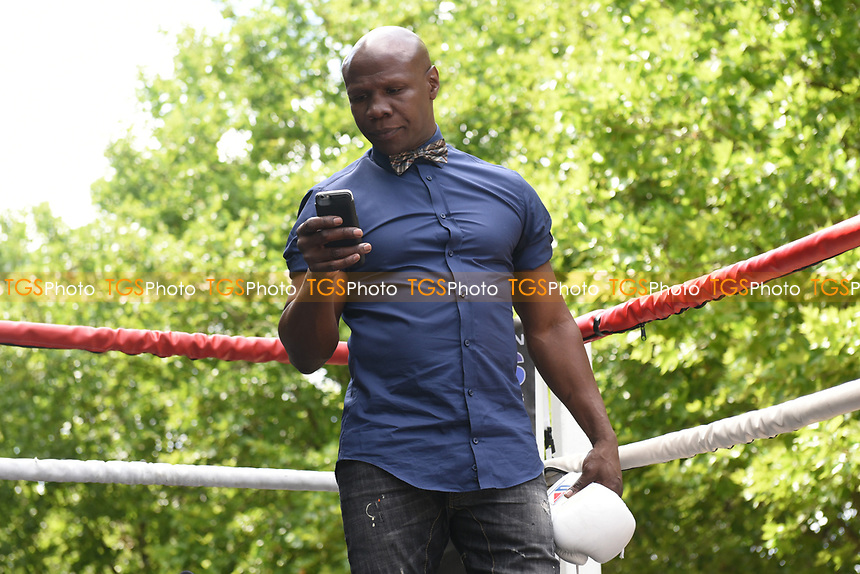 Chris Eubank checks his phone during a Public Work Out at ITV Head Office on 12th July 2017