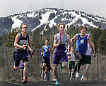 LEAD, S.D. -- MAY 4, 2013 -- Runners in the boys 4x100m relay race down the back stretch with a snow-capped Terry Peak as a backdrop at the 2013 Mountain West Invitational T&F Meet Saturday at Mountain Top in Lead, S.D.  (Photo by Richard Carlson/dakotapress.org