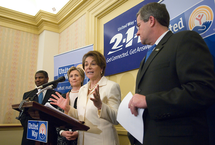 From left, former Secretary of Transportation and United Way of America board of trustees chairman Rodney Slater, Sen. Hillary Clinton, D-N.Y., Rep. Anna Eshoo, D-Calif., and United Way preident and CEO Brian Gallagher participate in the news conference in the U.S. Capitol to highlight the introduction of legislation for the national three digit dialing system for community and volunteer services on Tuesday, Feb. 13, 2007.