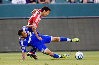 Kansas City Wizards forward Teal Bunbury and Chivas USA midfielder Jonathan Bornstein fight for a loose ball. The Kansas City Wizards defeated CD Chivas USA 2-0 at Home Depot Center stadium in Carson, California on Sunday September 19, 2010.
