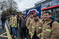 Penny Mordaunt MP is prevented from driving into West Norwood Fire Station by angry FBU members in dispute over pension cuts. London 25-11-14 The MP (who is the Fire minister) was meant to be opening the new Fire Station instead she was driven away until more Police arrived to control the crowd. There were no arrests.