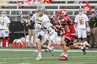 Towson, MD - March 25, 2017: Towson Tigers Jon Mazza (9) avoids the Denver Pioneers defender during game between Towson and Denver at  Minnegan Field at Johnny Unitas Stadium  in Towson, MD. March 25, 2017.  (Photo by Elliott Brown/Media Images International)