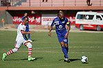 Palestinian players of Hilal al-Quds football club (in blue) compete with Palestinian players of Shabab Khan Younis football club (in white) during the first leg football match of the Palestine Cup final at the Palestine Stadium in Gaza City on June 20, 2018. Photo by Mahmoud Ajour