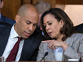 United States Senators Cory Booker (Democrat of New Jersey), left, and Kamala Harris (Democrat of California) converse during the hearing on the nomination of Judge Brett Kavanaugh before the US Senate Judiciary Committee on his nomination as Associate Justice of the US Supreme Court to replace the retiring Justice Anthony Kennedy on Capitol Hill in Washington, DC on Friday, September 7, 2018.<br /> Credit: Ron Sachs / CNP